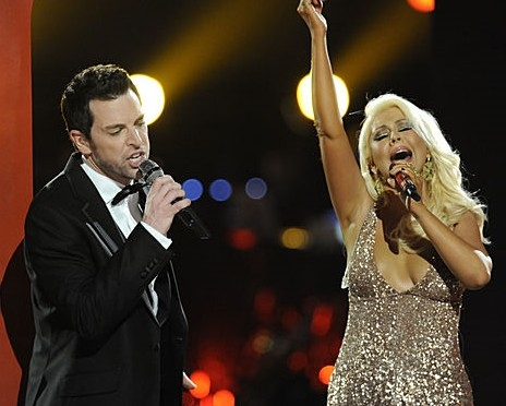 Chris Mann and his television coach Christina Aguilera singing a duet during season two of The Voice.