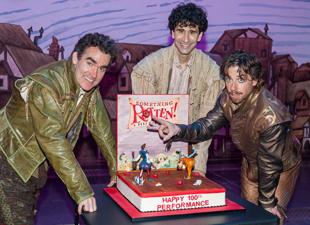 Something Rotten's leading men Brian d'Arcy James, John Cariani, and Christian Borle pose with their 100th performance cake.