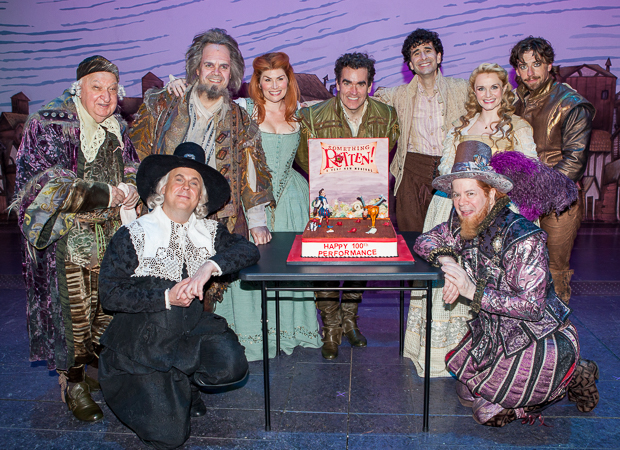 Gerry Vichi, Brad Oscar, Heidi Blickenstaff, Brian d'Arcy James, John Cariani, Kate Reinders, Christian Borle, Brooks Ashmanskas, and Peter Bartlett pause for a photo before digging in.