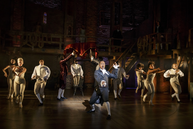 Leslie Odom, Jr. as Aaron Burr with the company of of Lin-Manuel Miranda's Hamilton, directed by Thomas Kail, at The Richard Rodgers Theatre.