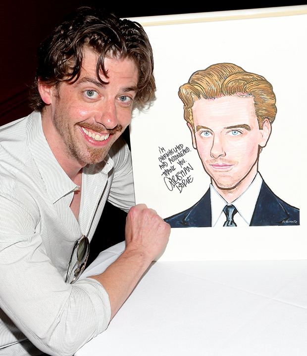Christian Borle poses with his brand new caricature at Sardi's.
