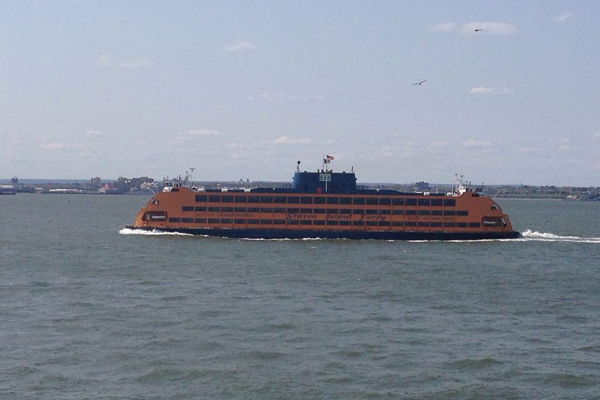 A scene from Jessie Bear's Ferry Play, directed by Erin B. Mee, on the Staten Island Ferry for FringeNYC.