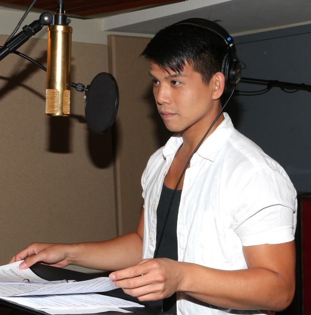Telly Leung records a track for his new album at Yellow Sound Studios.