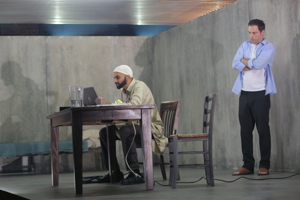 Usman Ally and Justin Kirk in the New York Theatre Workshop production of Ayad Akhtar's The Invisible Hand.
