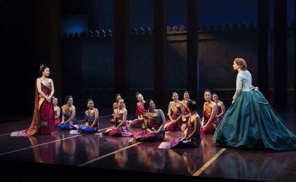 Ruthie Ann Miles, Kelli O'Hara, and the King and I company onstage at Lincoln Center.