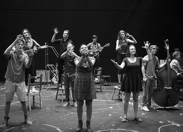 Krysta Rodriguez (center) and the cast of Spring Awakening performs The Song of Purple Summer in their rehearsal room.
