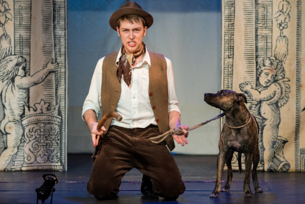 Evan Fazziola as Launce and Dinah as Crab in TP&co's production of William Shakespeare's The Two Gentlemen of Verona, directed by Christian Amato, at the Players Theatre.