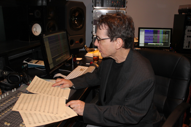 Larry Hochman studies a piece of music in the studio.