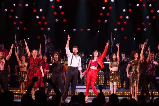 Josh Segarra and Ana Villafañe (center) lead the cast of Gloria Estefan, Emilio Estefan, and Alexander Dinelaris' On Your Feet!, directed by Jerry Mitchell, at the Marquis Theatre.