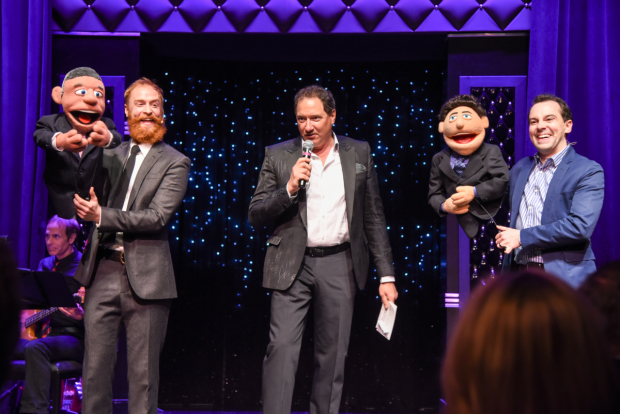 Avenue Q producer Kevin McCollum (center) is feted with former cast members Rob Morrison (left), Rob McClure (right),  and puppet friends.