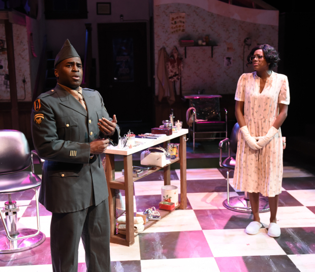 Omar Robinson as Bobby and Tasia A. Jones as Gladys in Katori Hall's Saturday Night/Sunday Morning, directed by Dawn M. Simmons, at Lyric Stage Company of Boston.
