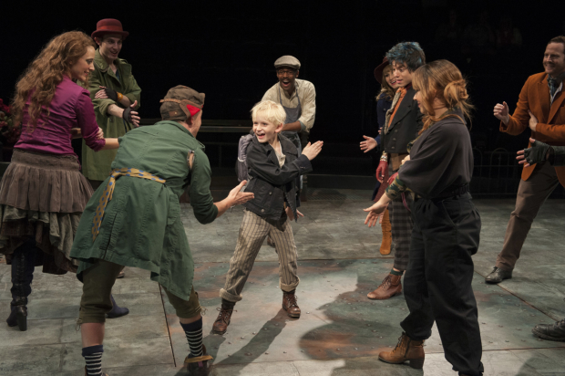 Jake Heston Miller (center) plays Oliver in Arena Stage's production of Oliver!