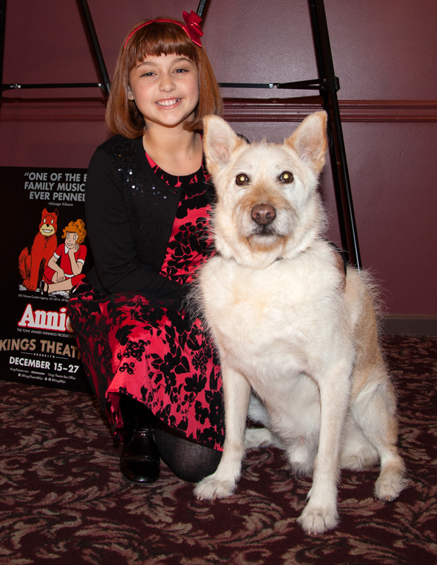 Annie star Issie Swickle poses with Annie's lovable dog, Sandy.