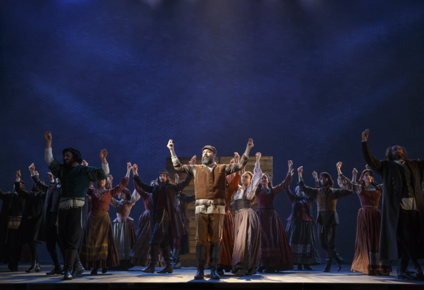 Danny Burstein leads the cast of Fiddler on the Roof, directed by Bartlett Sher, at the Broadway Theatre.