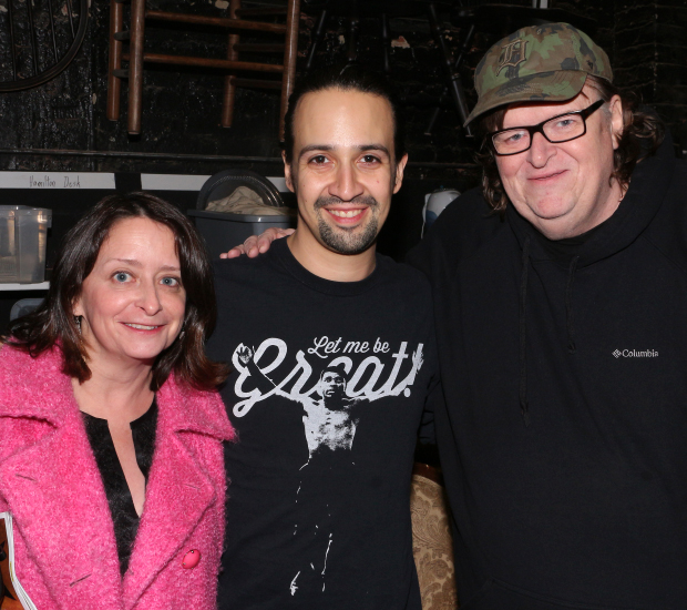 Lin-Manuel Miranda visits with Rachel Dratch and Michael Moore following a recent performance of Hamilton.