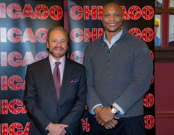 Eddie George poses for photos with longtime Chicago producer Barry Weissler.