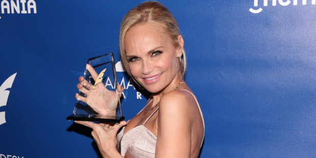 Kristin Chenoweth shows off her 2015 Drama Desk Award for On the Twentieth Century.