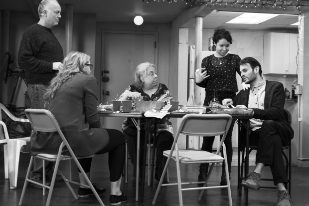 Erik (Reed Birney), Aimee (Cassie Beck), Deirdre (Jayne Houdyshell), and Brigid (Sarah Steele) listen as Rich (Arian Moayed) explains his trust fund in The Humans.