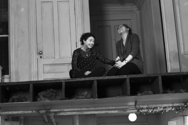 Sisters Brigid (Sarah Steele) and Aimee (Cassie Beck) share a moment on the second floor of David Zinn's duplex set in Stephen Karam's The Humans.
