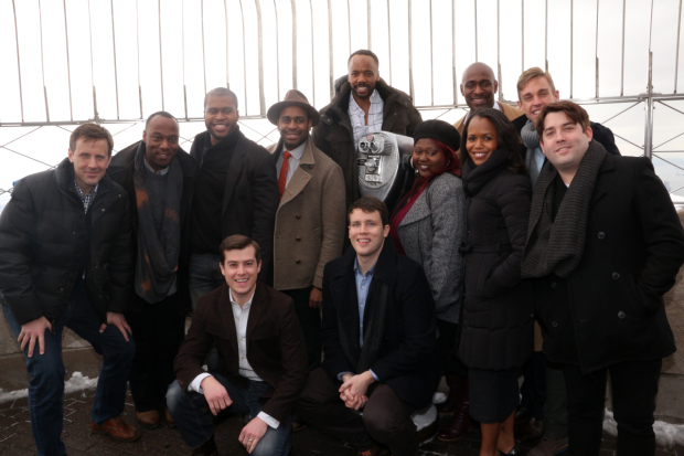 The company of The Book Of Mormon heads up to the top of the Empire State Building.