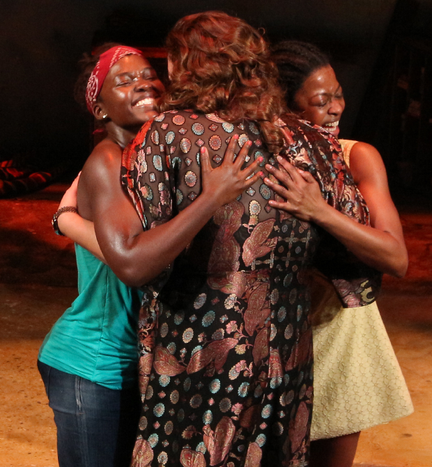 Lupita Nyong'o and Pascale Armand get a hug from director Liesl Tommy.