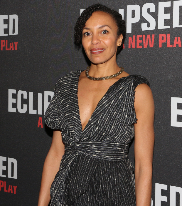 House of Cards cast member Eisa Davis proudly takes photos at the opening of Eclipsed.