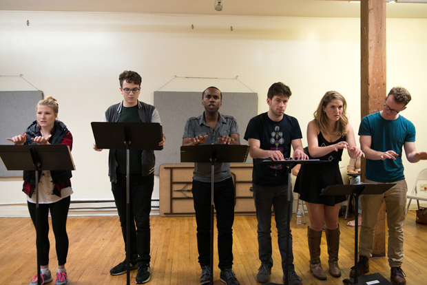 A moment in rehearsal with the ensemble of The Crazy Ones.