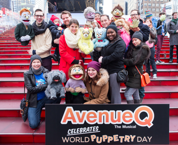 The human and puppet cast of Avenue Q celebrates World Puppetry Day.