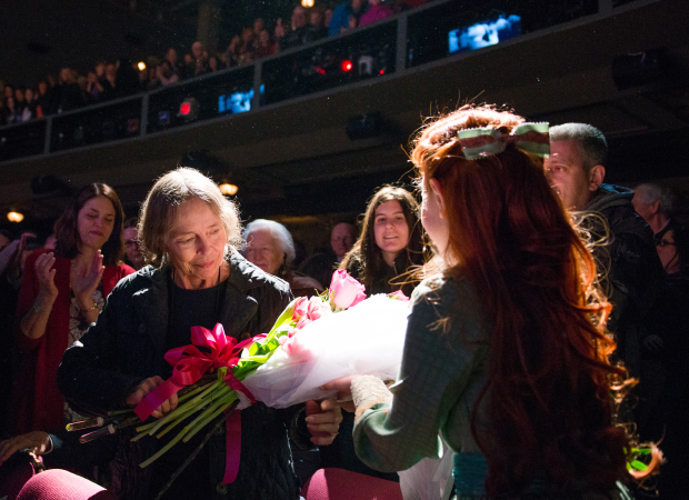 Tuck Everlasting star Sarah Charles Lewis presents Natalie Babbitt with a bouquet of flowers.