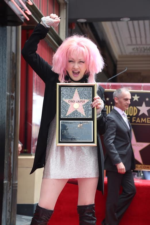 Cyndi Lauper is thrilled to show off her latest honor.