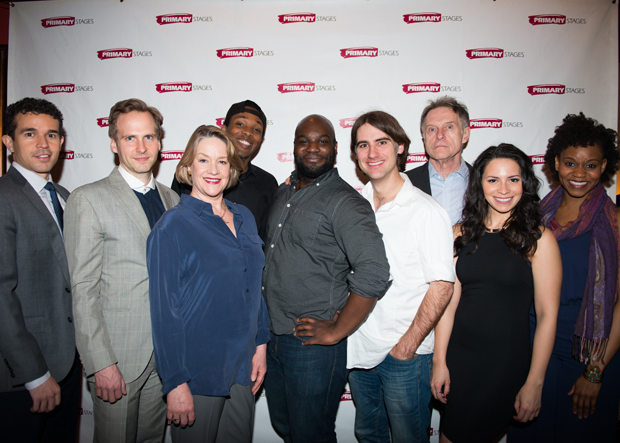 Playwright Ike Holter and director Kip Fagan (center) join their cast for a family photo.