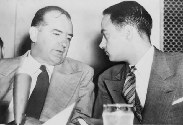 Joseph McCarthy (left) led the House Un-American Activities Committee, which resulted in a modern-day witch hunt that implicated the playwright Arthur Miller in Communist activities. Roy Cohn (who had a fictionalized role in Angels in America is seen here with McCarthy.