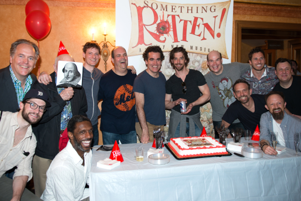 The men of Something Rotten pose with the show's anniversary cake.