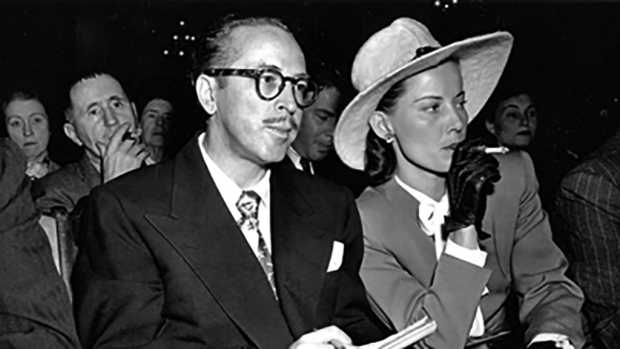 "Dalton Trumbo, seen here with his wife, Cleo, was one of the ""Hollywood Ten,"" a group of writers and directors who were blacklisted for their refusal to discuss their political affiliations with the House Un-American Activities Committee. Arthur Miller used this Communist witch-hunt as the inspiration for The Crucible. Bertolt Brecht can be seen here seated behind Trumbo at a 1947 HUAC hearing."