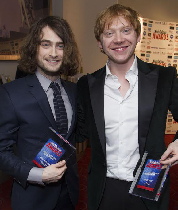 Harry Potter stars Daniel Radcliffe and Rupert Grint show off their 2014 WhatsOnStage Awards for The Cripple of Inishmaan and Mojo, respectively.