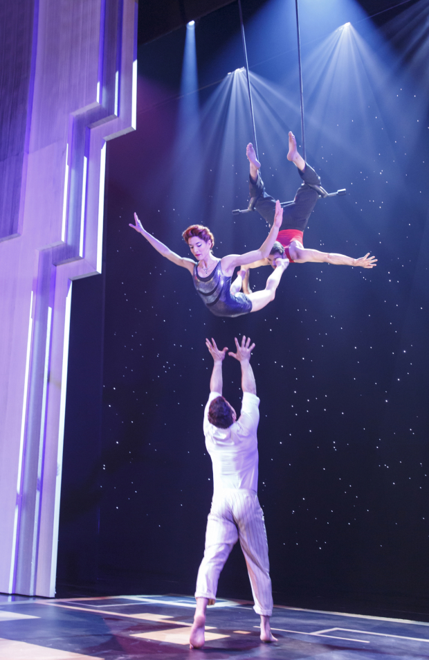 Martin Charrat, Myriam Deraiche, and Samuel William Charlton perform a trapeze love triangle in Paramour.