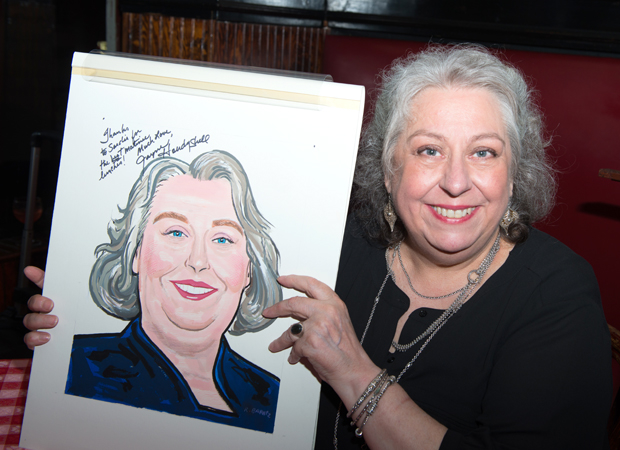 Jayne Houdyshell poses proudly with her Sardi's drawing.