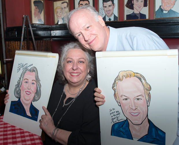 Jayne Houdyshell and Reed Birney hold up their Sardi's caricatures.