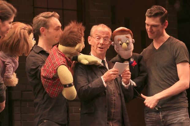 Joel Grey officiates a vow renewal between Avenue Q characters Ricky and Rod.