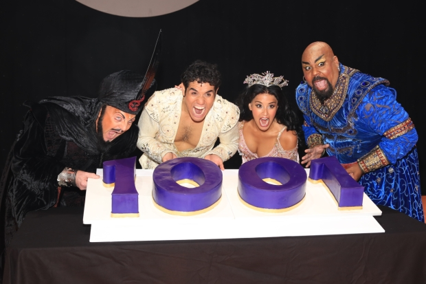 Jonathan Freeman, Adam Jacobs, Courtney Reed, and James Monroe Iglehart can't wait to take a bite out of their celebratory cake.