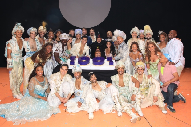 The cast of Disney's Aladdin pose with their cake.