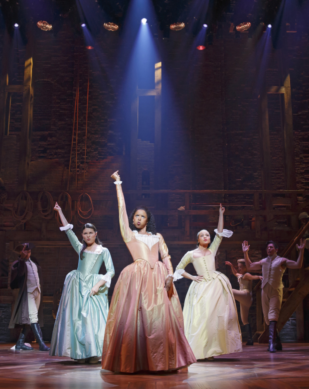 Renée Elise Goldsberry (center) with Phillipa Soo and Jasmine Cephas Jones in a scene from Hamilton on Broadway.