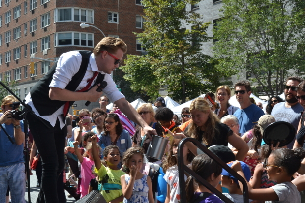 The Amazing Max performing at TheaterMania's annual street fair.