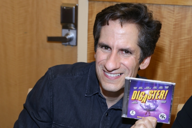 Seth Rudetsky shows off a copy of the new original cast recording of DIsaster!
