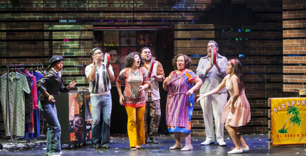"""Caridad De La Luz, Joseph """"Quique"""" González, Shadia Fairuz, Angel López, Rossmery Almonte, Tito Nieves, and Ana Isabelle star in I Like It Like That, directed by Waddys Jáquez, at Puerto Rican Traveling Theater."""