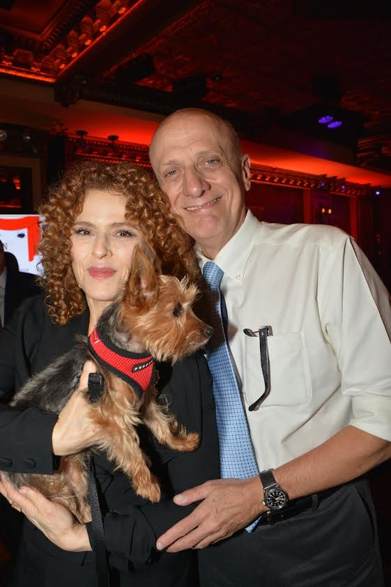 Bernadette Peters and honoree Tom Viola pose with a furry friend.