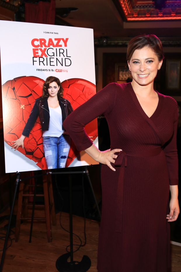 Rachel Bloom poses with a photo of herself as the show's logo.