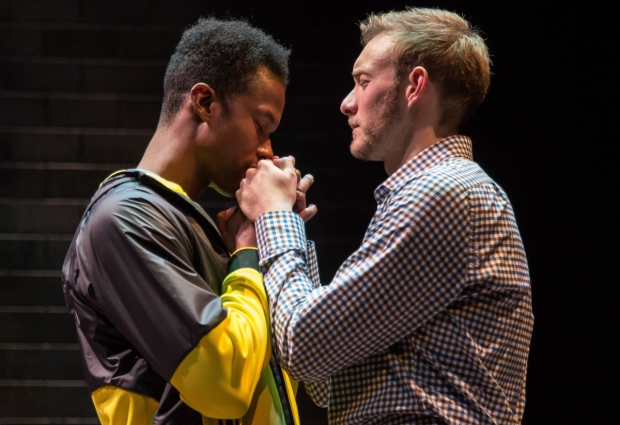 Sean Parris (The Diver) and Brett Schneider (The Magician) in the world premiere of Andrew Hinderaker's The Magic Play, directed by Halena Kays, at the Goodman Theatre.