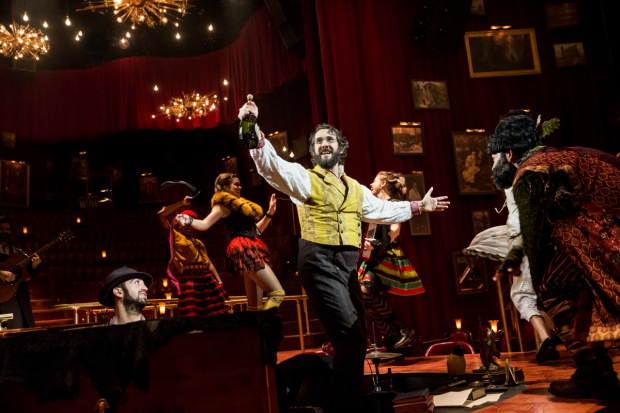 Music director Or Matias and Paul Pinto look on as Josh Groban raises a bottle in Natasha, Pierre & The Great Comet of 1812.