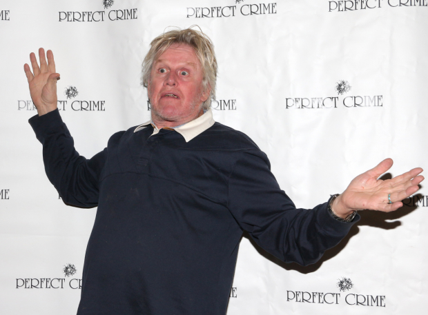 Gary Busey poses for a photo in honor of his engagement in Perfect Crime.